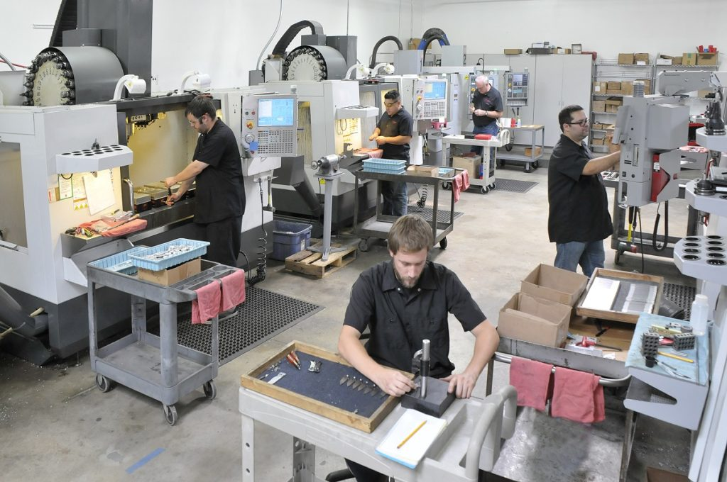 Employees operating machines