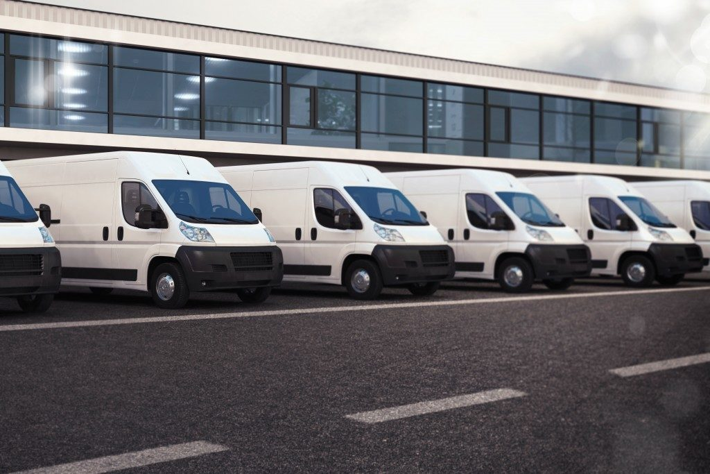 parked delivery vans in a row
