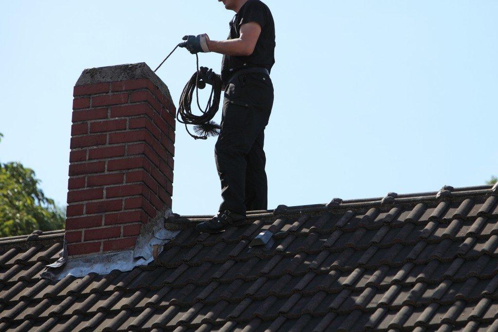 man checking chimney
