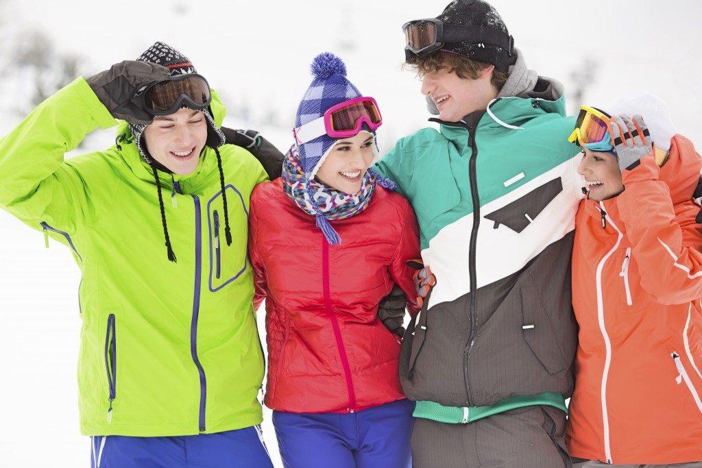 people wearing snow gears