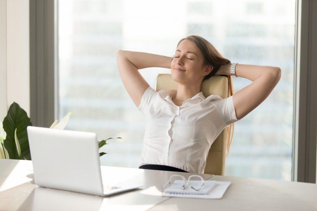 businesswoman relaxing in her office