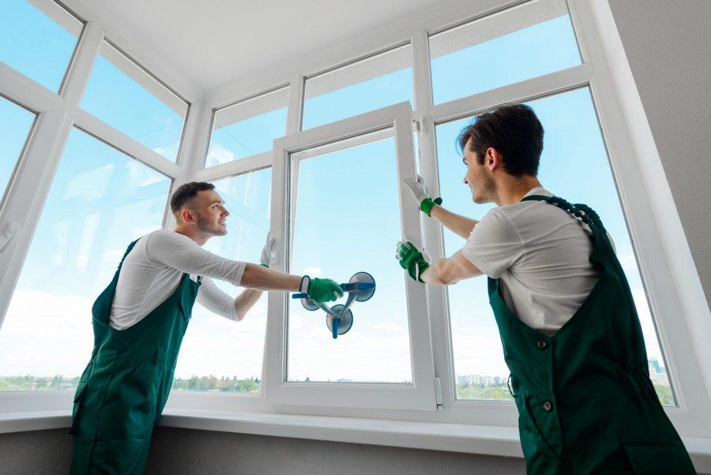 workers installing windows