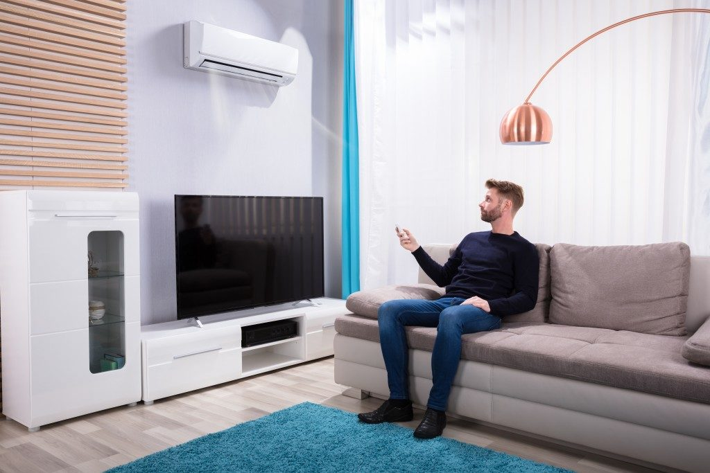 man in the living room using the ac