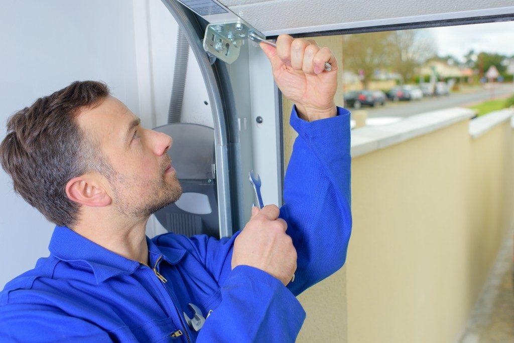 Man installing garage door
