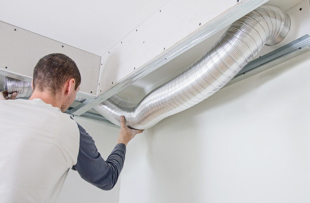 contractor installing HVAC system