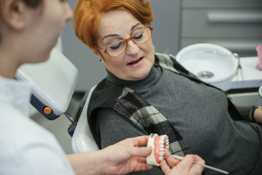 Woman looking at dentures