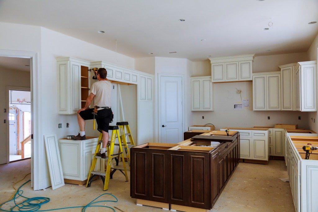 Man renovating a kitchen