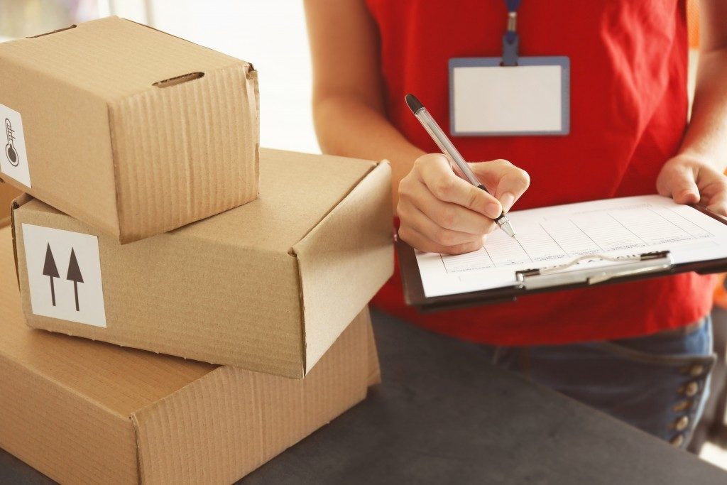 man checking all boxes packed