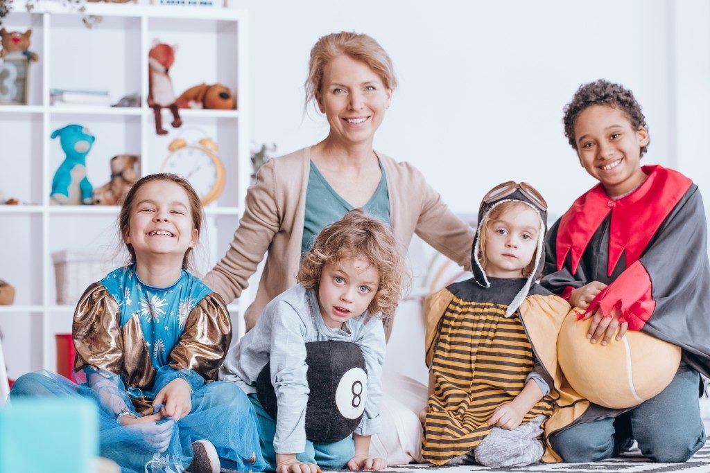 teacher with children dressed up