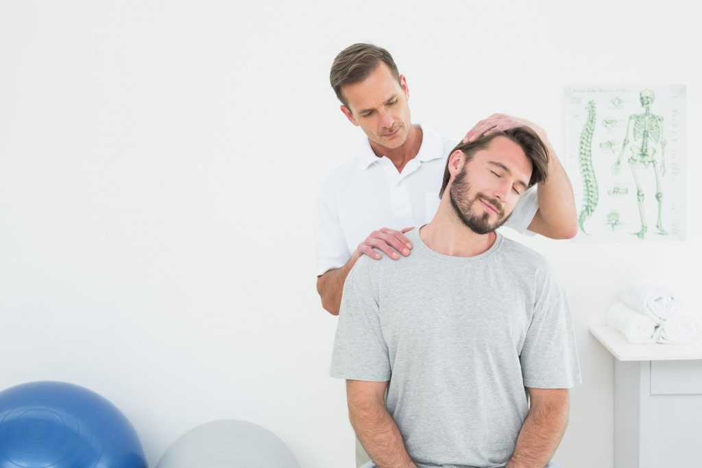Men getting chiropractic treatment